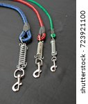 Small photo of Pet leash three color and three size spring hook on black background. Good pet supplies