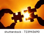 two hands trying to connect... | Shutterstock . vector #723943690
