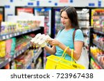 woman buys tinned meat | Shutterstock . vector #723967438