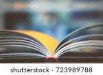 open book on working desk in... | Shutterstock . vector #723989788