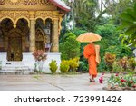 monk with an umbrella on a city ... | Shutterstock . vector #723991426