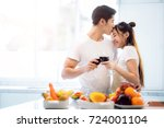 asian couple making food for... | Shutterstock . vector #724001104