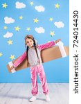 little child girl in an... | Shutterstock . vector #724014430