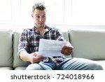 shocked man holding some... | Shutterstock . vector #724018966