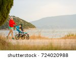 mother with child in stroller... | Shutterstock . vector #724020988