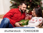 happy young couple holding... | Shutterstock . vector #724032838