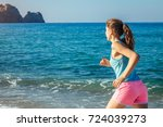 young woman running on the... | Shutterstock . vector #724039273