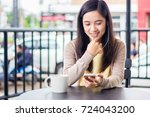asian woman talking through... | Shutterstock . vector #724043200
