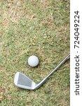 golf ball and golf club on a... | Shutterstock . vector #724049224