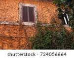 wall of an old house italy | Shutterstock . vector #724056664