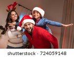 happy father in santa hat... | Shutterstock . vector #724059148