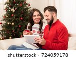 happy young couple using... | Shutterstock . vector #724059178
