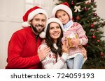 happy young family with one... | Shutterstock . vector #724059193