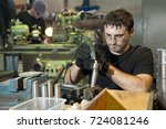 worker make something at plant | Shutterstock . vector #724081246