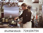 food concept. a young cook... | Shutterstock . vector #724104754