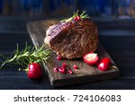 baked meat with rosemary and... | Shutterstock . vector #724106083