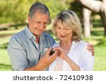 mature couple looking at their... | Shutterstock . vector #72410938