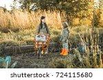 the children on the harvest of... | Shutterstock . vector #724115680