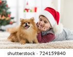 little boy and dog lying at... | Shutterstock . vector #724159840