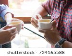 in coffee shop  four people... | Shutterstock . vector #724165588