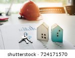 house and house key resting on... | Shutterstock . vector #724171570
