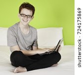 teenage boy sitting on a bed... | Shutterstock . vector #724175869