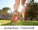 woman runner running in nature  ... | Shutterstock . vector #724231108