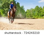 young woman riding bay horse at ... | Shutterstock . vector #724243210