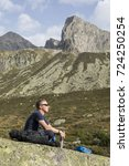 Small photo of Alpinist meditates according to the meaning of life