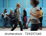 students friends at lockers room | Shutterstock . vector #724257160
