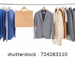 Small photo of men's different , shirt ,coat, jacket ,coat, shopping , bag, on hangers men's different , shirt ,coat, jacket ,coat, shopping , bag, on hangers