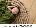 infant baby boy wrapped in...   Shutterstock . vector #724302208
