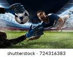 goalkeeper catches the ball in... | Shutterstock . vector #724316383