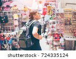 young man traveler is visiting... | Shutterstock . vector #724335124
