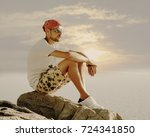 Young Man Watching The Sunset...