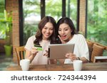 two asian woman using laptop...   Shutterstock . vector #724344394
