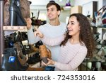 happy young couple buying... | Shutterstock . vector #724353016