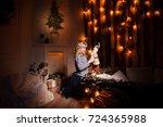little beautiful girl at home... | Shutterstock . vector #724365988