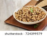 red quinoa brown rice served in ... | Shutterstock . vector #724399579