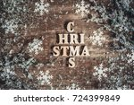 christmas word made of wooden... | Shutterstock . vector #724399849