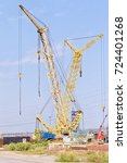 Small photo of The production base of steel structures and petrochemical machine with crawler cranes under the open sky