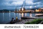 three men fishing after sunset... | Shutterstock . vector #724406224