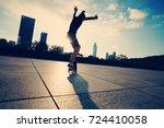 woman skateboarder... | Shutterstock . vector #724410058