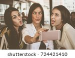 Smiling Women Taking Selfie...