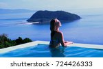 the girl in the pool in the... | Shutterstock . vector #724426333