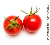 two fresh tomato isolated on... | Shutterstock . vector #724439380