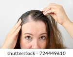 woman is checking white hair... | Shutterstock . vector #724449610