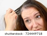 woman is checking white hair...   Shutterstock . vector #724449718