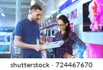 in the electronics store... | Shutterstock . vector #724467670