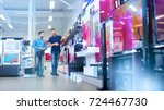 in the electronics store... | Shutterstock . vector #724467730